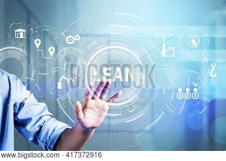 Businessman Hand Touching Digital Glass Screen To Discover Lean Quality Control And Manufacturing Pr