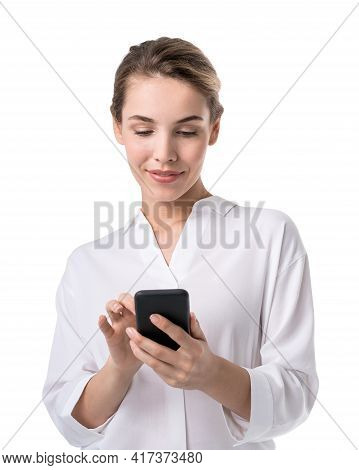 Office Blonde Woman In White Shirt, Business Clothes, Using Smartphone In Hands, Smiling. Concept Of