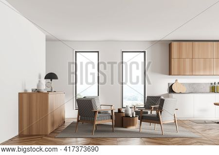 Stylish Interior Of Bright And White Modern Kitchen Room. Armchairs Livingroom Zone Open Space. 3d R