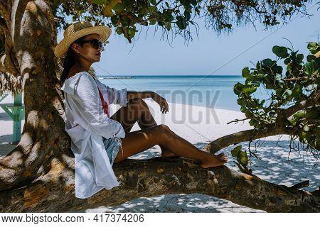 Palm Beach Aruba Caribbean, White Long Sandy Beach With Palm Trees At Aruba Antilles, Woman Mid Age