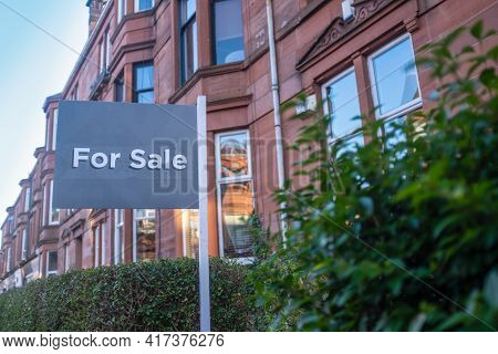 A For Sale Sign Outside A Traditional Red Sandstone Tenement Flat (apartment) In Glasgow
