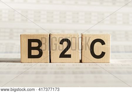 B2c Abbreviation - Business To Consumer, On Wooden Cubes On A Light Background.