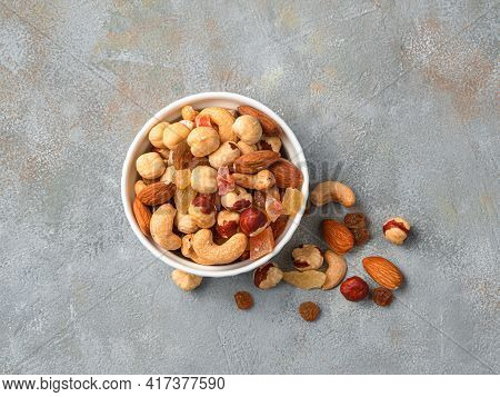 Cup With Nuts And Dried Fruits On A Gray Background, Close-up. Healthy Food.
