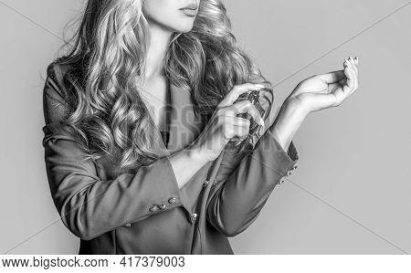 Beautiful Girl Using Perfume. Woman With Bottle Of Perfume. Woman Presents Perfumes Fragrance. Perfu
