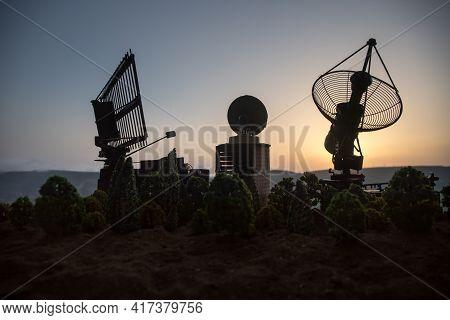 Space Radar Antenna On Sunset. Silhouettes Of Satellite Dishes Or Radio Antennas Against Night Sky.