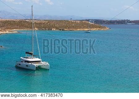 Monastiri Beach, Paros Island, Greece - 27 September 2020: A Catamaran Moored In The Bay Of Monastir