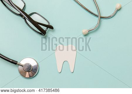 Health Dental Care Concept. Medicine Equipment Stethoscope White Healthy Tooth Glasses Isolated On P