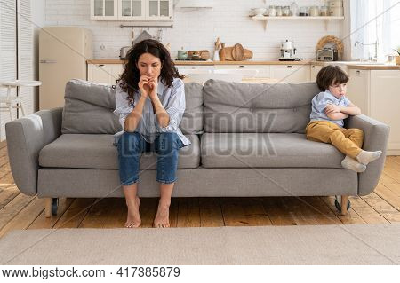 Offended Mom And Son Sit On Couch In Living Room Avoid Talking And Looking At Each Other After Quarr
