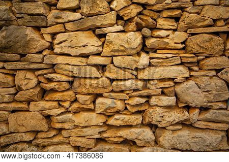 Background Of Stone Wall Texture Of Architecture In Old Town Of Vela Luka, Korcula Island, Croatia