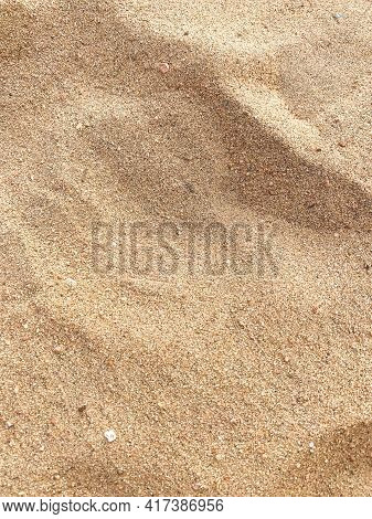 Phone Photography Of Natural Sand Stone Texture Background. Sand On The Beach As Wallpaper. Wavy San