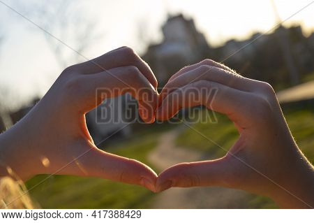 Heart Folded From Female Hands In The Rays Of Sunset, Heart Is A Symbol Of Love, Fidelity And Sympat