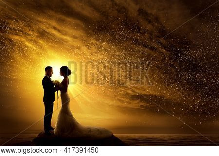 Wedding Couple Silhouette. Bride And Groom Over Yellow Sunshine Sunset. Romantic Couple At Night Sky