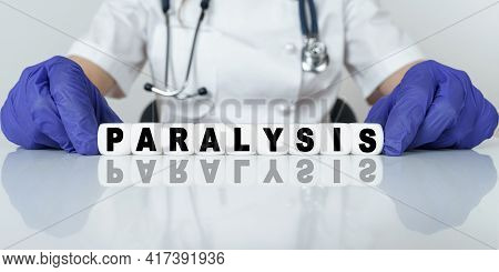 Medicine And Health Concept. The Doctor Put Together A Word From Cubes Paralysis