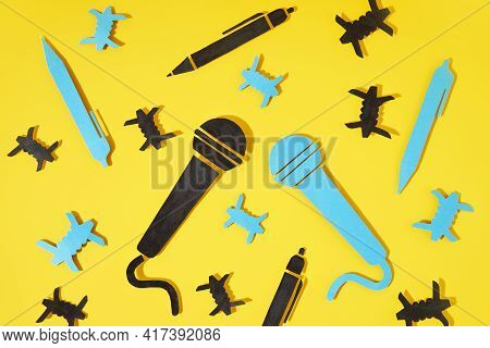 World Press Freedom Day Concept. A Blue And Black Microphone And A Pen Made Of Paper, As A Symbol Of
