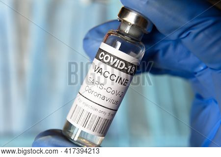 Coronavirus Vaccine Vial Closeup, Doctor Holds Bottle With Covid-19 Vaccine For Injection. Concept O
