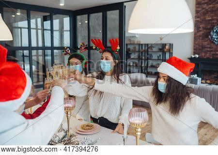 Multi-ethnic Young People Celebrating New Year Eve At Party