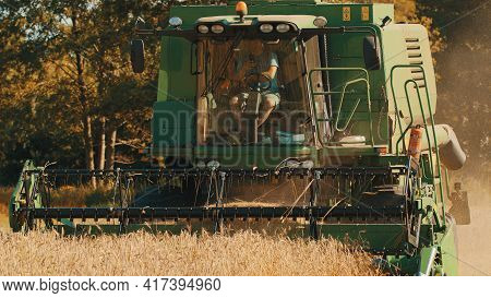 Warsaw, Poland 10.08.2020 - Front View Of A Combine Harvester. Farmer Driving The Harvester Working