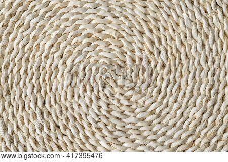 Round Braided Natural Staw Table Mat Texture As A Background. Full Frame Of Tightly Woven Straw Patt