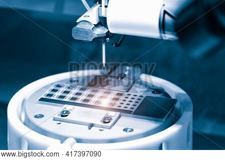 Close Up Of Examining Of Test Sample Of Microchip Transistor Under The Microscope In Laboratory. Equ
