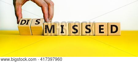 Missed Or Dismissed Symbol. Businessman Turns Cubes And Changes The Word 'missed' To 'dismissed'. Be