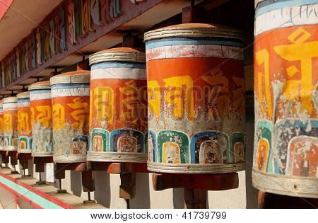 Prayer wheels at Zang Dhok Palri Phodang, a Buddhist monastery in Kalimpong in West Bengal, India. poster