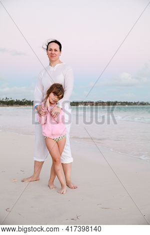 Real Family Outdoor Portrait On A Beach In Dominican Republic, Young Mother With Cute Little Daughte
