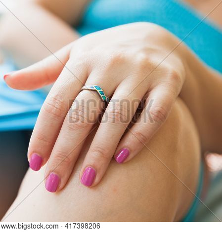Female Hand With Silver Ring With Larimar Stones, Close Up Photo With Selective Focus