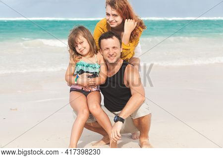 Real Family Outdoor Portrait On A Beach In Dominican Republic, Young Father With Two Daughters On A