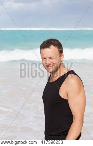 Young Adult Handsome Caucasian Man In Black Shirt Walk On The Beach In A Sunny Summer Day, Dominican