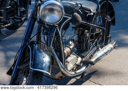 Close-up Of Motorcycle Parked On City Street