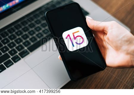 Iphone With Ios 15 Logo On The Screen Close Up, New Operating System 2021 On Apple Devices. Rostov-o