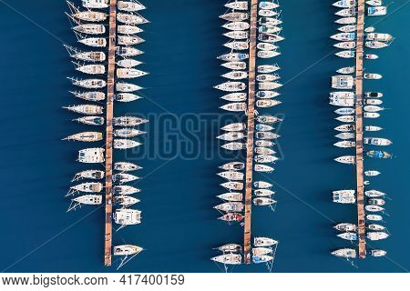 Aerial View Of The Yacht Club. Aerial Top-down View Of Docked Sailboats