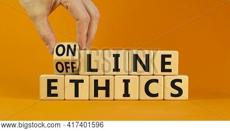 From Offline To Online Ethics. Businessman Turns A Cube And Changes The Words 'offline Ethics' To 'o