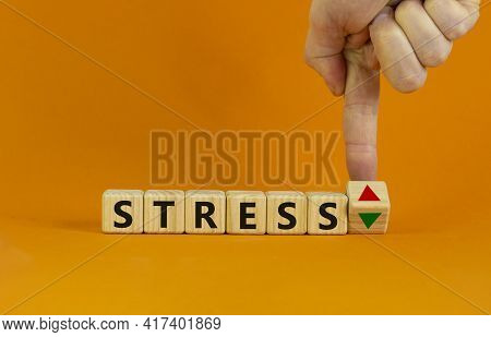 Stress Level Symbol. Doctor Turns A Cube And Changes The Expression 'stress Up' To 'stress Down'. Be