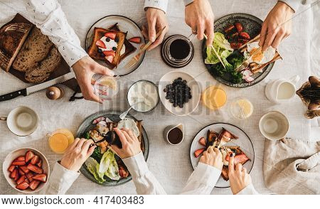 Family Or Friends Having Breakfast Or Brunch Together, Top View