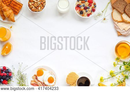 Healthy Breakfast With Muesli, Fruits, Berries, Nuts, Coffee, Eggs, Honey, Oat Grains And Other On W