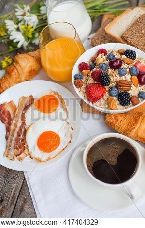 Healthy Breakfast With Muesli, Fruits, Berries, Nuts, Coffee, Eggs, Honey, Oat Grains And Other Clos