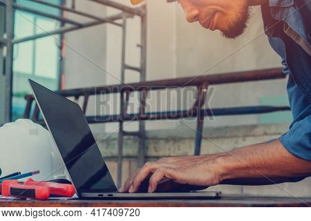 Worker Using Laptop Working On Site Building Construction , Man Occupation Engineer Employee