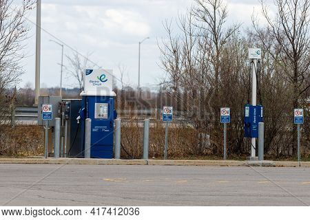 Ottawa, Ontario, Canada - April 12, 2021: A Public Charging Station For Electric Vehicles (evs) At T