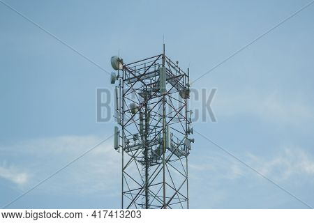 Transmission Tower Built High Under The Blue Evening Sky. Telecommunication Tower With 5g Cellular N