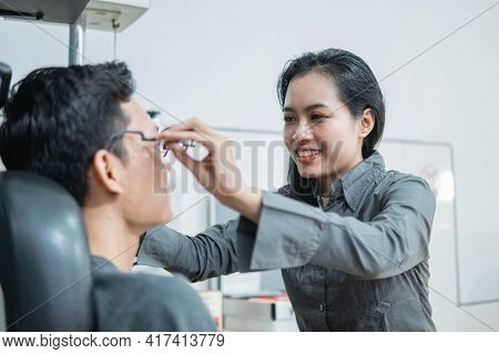 The Female Ophthalmologist Applies The Experimental Frame To The Patient
