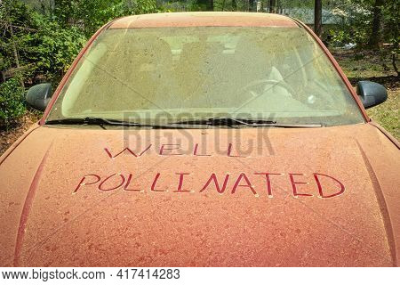A Thick Layer Of Pine Pollen On A Car Hood During Spring With A Funny Note Written In It That Could