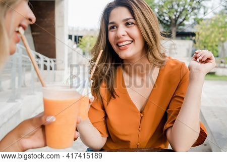 Two Friends Spending Time Together At Coffee