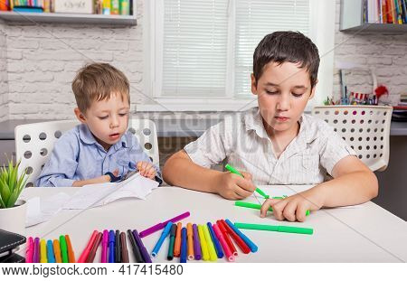 Cute Boys Studying Drawing At School. Happy Family Drawing Pictures. Kids Draw In Creativity At Home