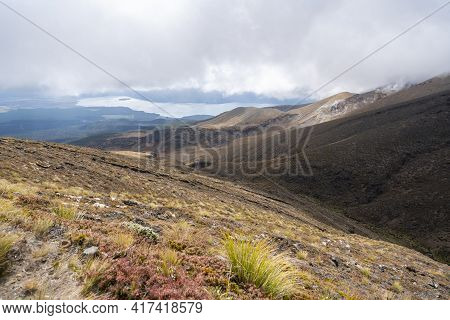 Valley View Between Mountains With Lake In Distance On Overcast Day In Tongariro National Park, New
