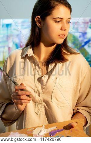 Female Artist. Inspiration Muse. Creating Artwork. Fine Art School. Thoughtful Woman Holding Palette