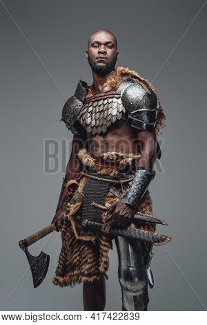 Brutal Medieval Barbarian With Hatchet And Swords In Gray Background