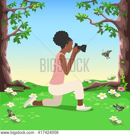 Beautiful Black Girl Photographer With A Camera Looks Into The Lens And Photographs A Butterfly In A