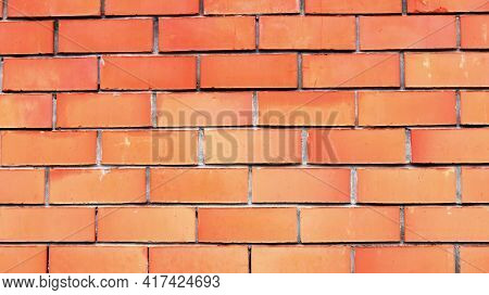 Terracotta Brick Wall With Clear Outline Of Blocks, Empty Brickwork Backdrop In Orange Color, Fragme