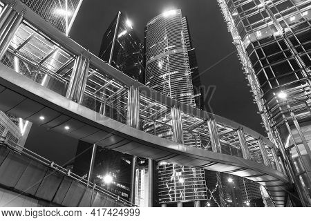 High Rise Modern Office Building In Midtown Of Hong Kong City At Night